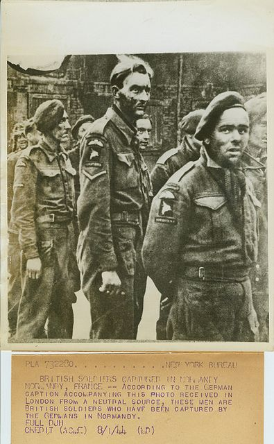 .British Soldiers Captured in Normandy.Normandy, France -- According to the German caption accompanying this photo received in London from a neutral source, these men are British soldiers who have been captured by the Germans in Normandy..Credit: ACME.Date: 8-1-44