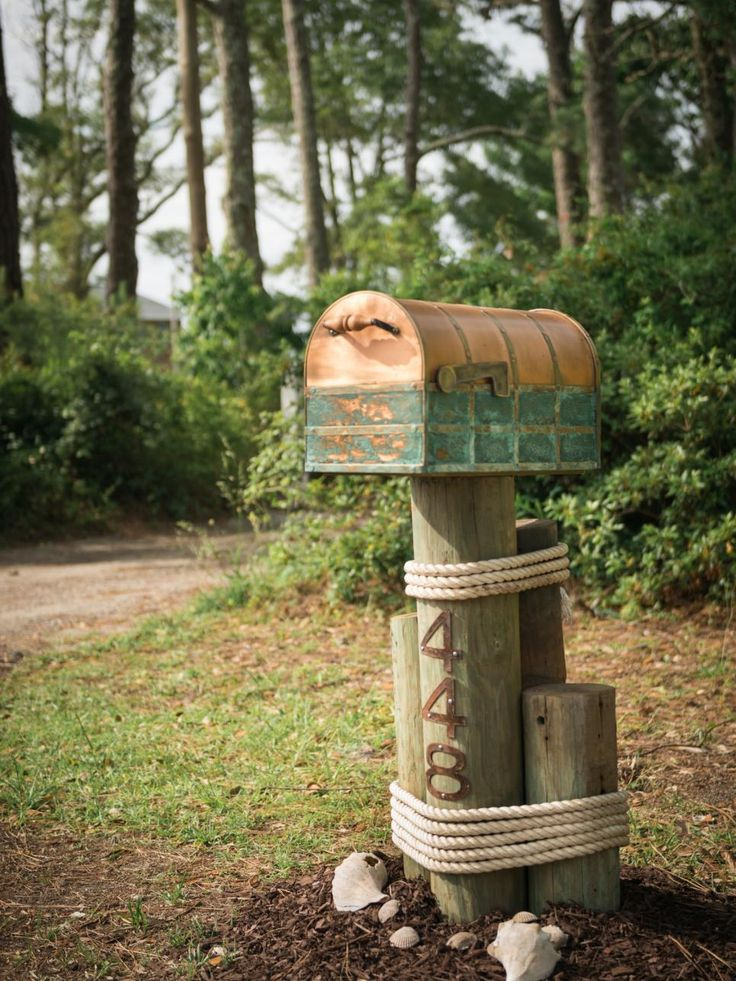 Propped atop maritime pilings, a copper mailbox, selected by online voters, suits the home's remote coastal location.