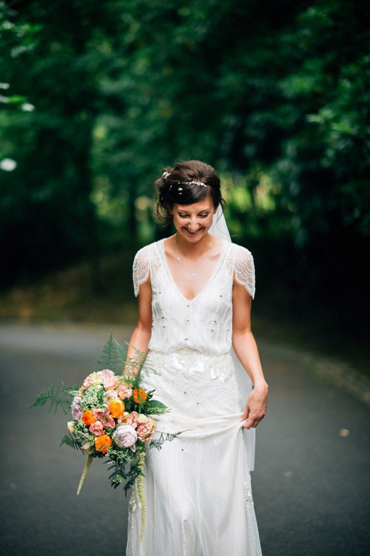 Bride wearing a beaded cap sleeved Jenny Packham dress.  Photography by http://www.kerrydiamondphotography.com/