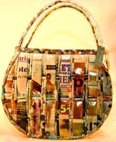 Recycled newspaper handbag. i love the design!