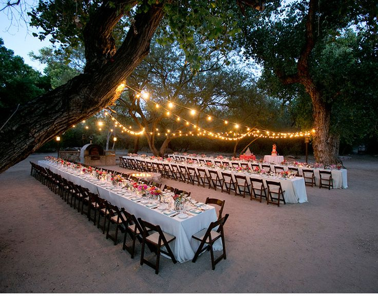 I love this reception.  The long banquet tables, market lights and bright colors really make this reception stand out!