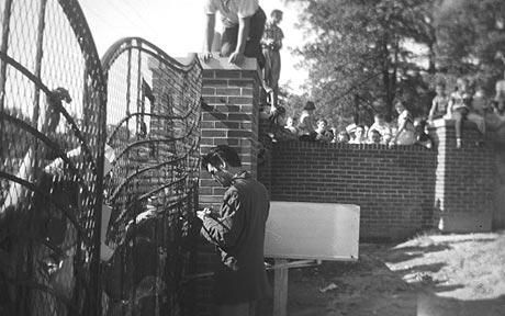 Elvis Presley archivists have found three rare photos dating back to 1957 that show the young singer greeting fans at the gates of Graceland