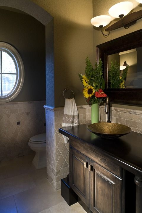 Traditional Bathroom with dark wood mirror frame