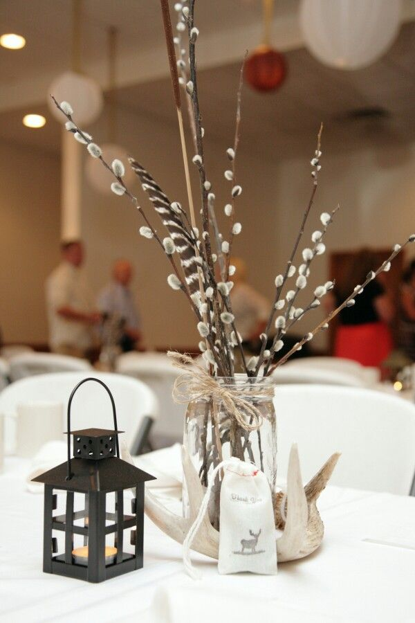 Hunting themed wedding centerpieces. So pretty!