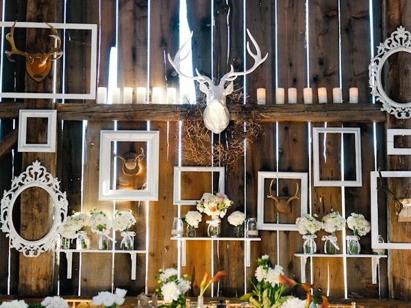 barn wedding, antlers, empty frames, flowers, candles, burlap, dinner reception