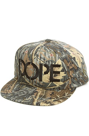 The Stencil Logo Snapback in Real Tree Camo