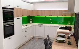 Glasgow display no.3. Talea doors in matt white laquer with some sonoma oak. Corian worktop in white jasmine with a green splashback. Bauknecht appliances.