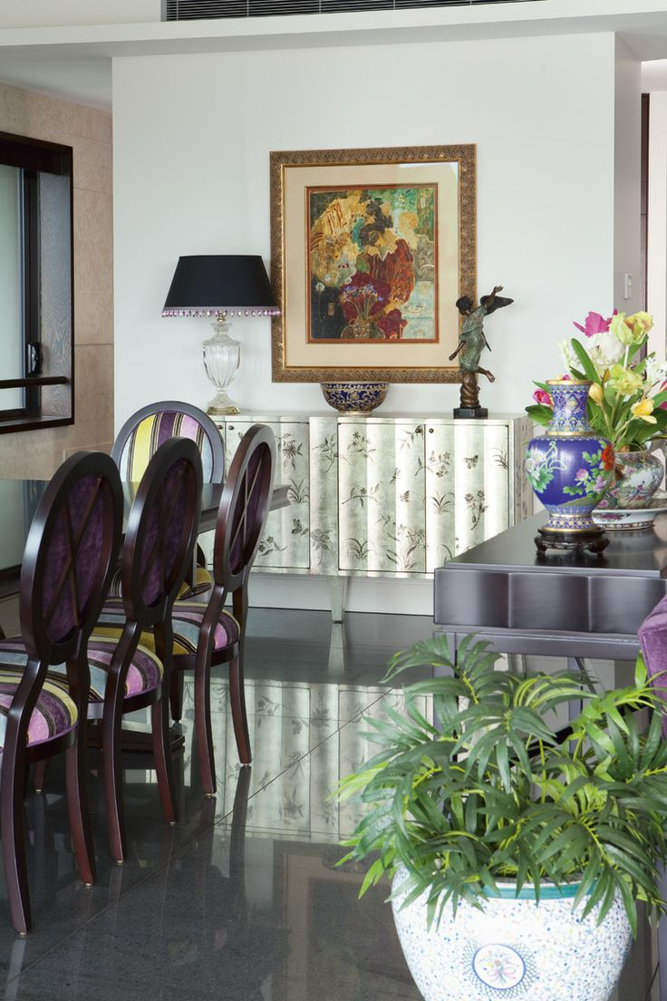 Dining Room Featuring A Ribbed Silver Leaf Buffet With Hand Painted Flowers And Butterflys