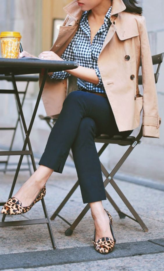 Opt for a tan trenchcoat and navy blue fitted pants for a work-approved look. This outfit is complemented perfectly with tan leopard suede loafers.   Shop this look on Lookastic: https://lookastic.com/women/looks/tan-trenchcoat-navy-dress-shirt-navy-skinny-pants/18049   — Navy Gingham Dress Shirt  — Tan Trenchcoat  — Navy Skinny Pants  — Tan Leopard Suede Loafers