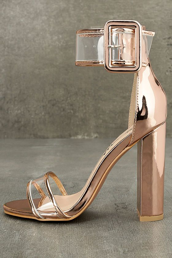 Party perfect has reached new heights with the Adara Rose Gold Ankle Strap Lucite Heels! Shining rose gold vegan leather frames a lucite toe strap, and wide matching ankle strap with adjustable covered buckle.