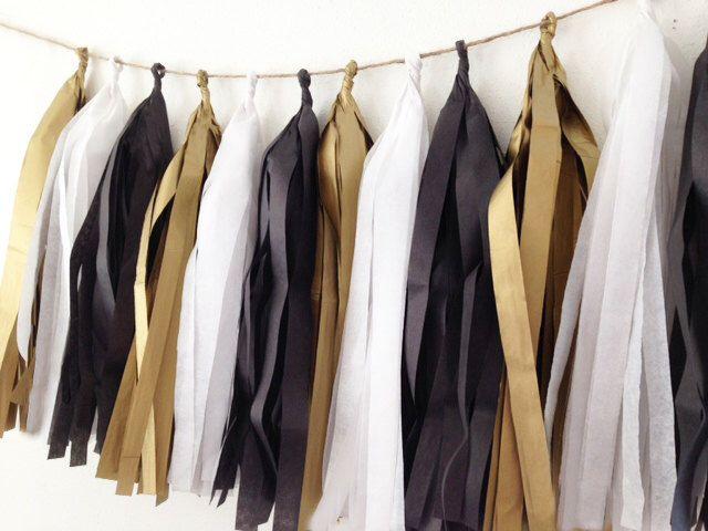 New Years Tassel garland | Tissue tassel garland | Tissue garland in antique gold, tuxedo black, & white for New Years | Wedding | Holidays by PomJoyFun on Etsy https://www.etsy.com/listing/193820046/new-years-tassel-garland-tissue-tassel