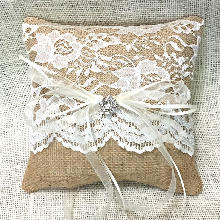 Elegant Lace and Rustic Burlap are featured in this lovely Burlap Ring Bearer Pillow. Measuring 8x8 inches, this burlap ring pillow features sweetly scalloped edged lace that covers 3/4 of the pillow