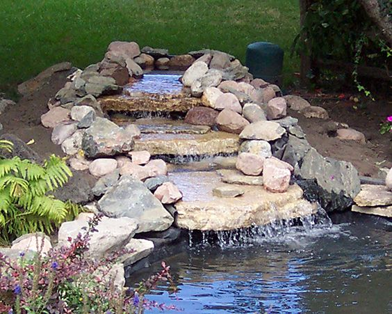 If your existing pond needs an update, consider adding a waterfall to spruce it up. A pump system, underlayment, concrete block, and whatever rocks, bricks, or stone you choose can be arranged to any size you want. Perennials or potted plants round out the look.