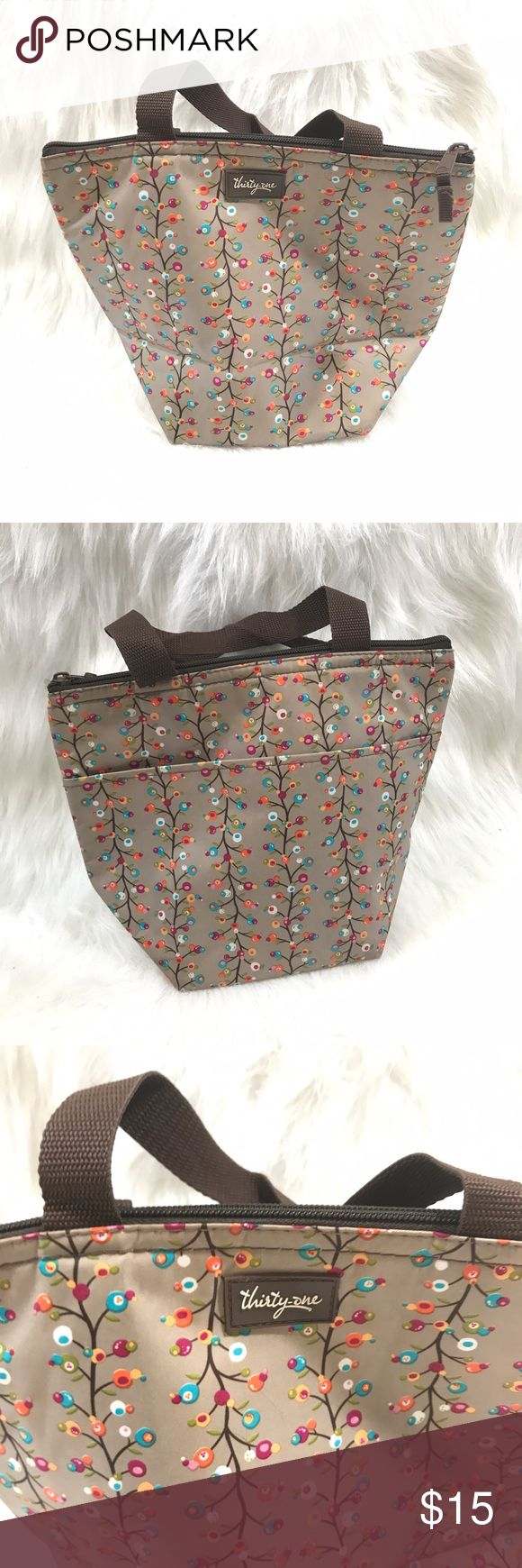 THIRTY ONE FLORAL BERRY ZIP TOP LUNCH BAG TOTE Good condition thirty one lunch bag with cute design. Inside keeps drinks and food cool. Outside pocket and a zip top. Great for the beach! thirty one Bags