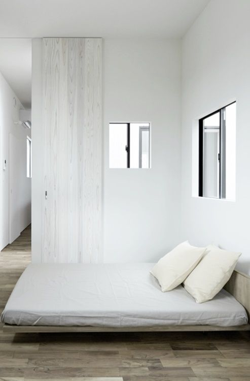 Japanese Interior Design - The simple look of this bedroom is a perfect example of how simple and modern Japanese interiors are. It has been designed with a light color scheme to compliment the simplicity of the design. The sliding door is a slick nod to the traditional shoji screens. Peaceful and restful describe this room perfectly.