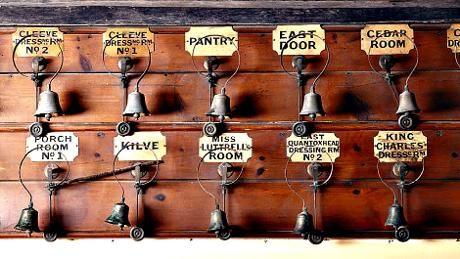 Servants bells in the basement corridor at Dunster Castle, Somerset