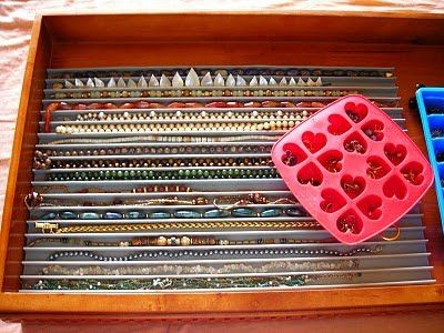 Love this idea for organizing necklaces.  I would love to have a cabinet or sorts with only fabric lined shallow drawers to store jewelry in . . . .