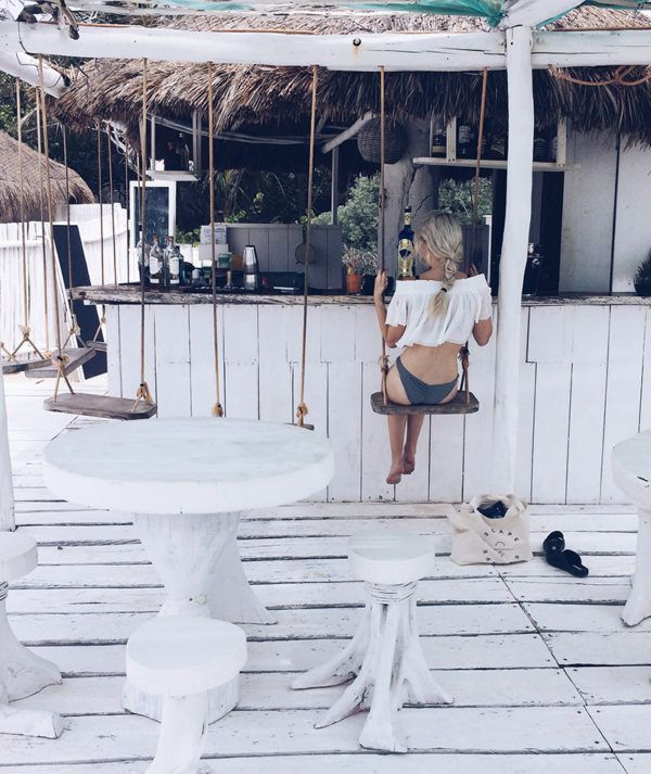 Beach bar with bar swings | taking some time off at an inventive bar on the beach