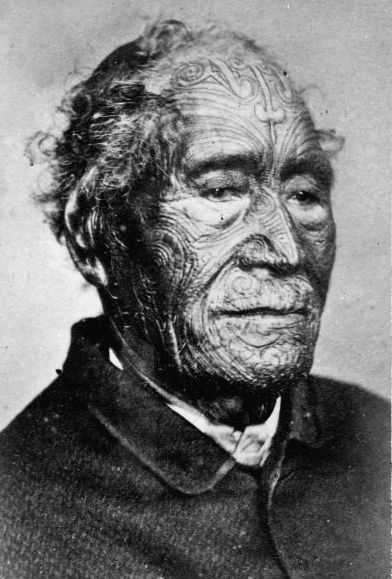 Portrait of Tāmati Wāka Nene, (1780-1871), Māori chief, Hokianga, Northland, New Zealand. c.1860s. Tā moko is the permanent body and face marking by Māori, the indigenous people of New Zealand. Traditionally it is distinct from tattoo and tatau in that the skin was carved by uhi (chisels) rather than punctured. This left the skin with grooves, rather than a smooth surface.