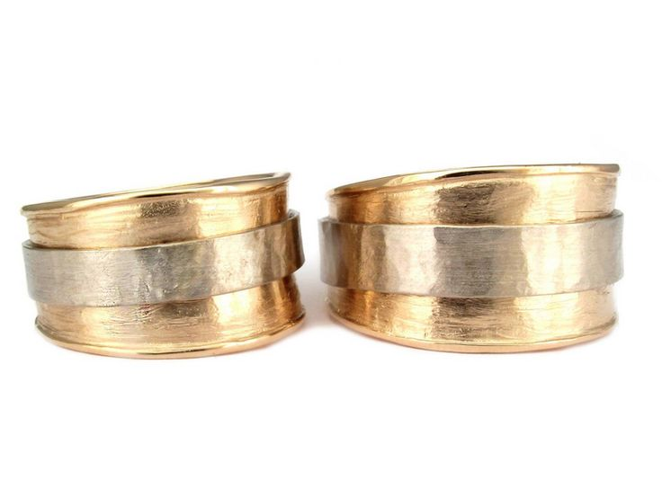 Custom wedding bands hot off the bench of in-house designer Jilian Maddin. Stunning 14k white and yellow gold spinning rings. #madeyoulook  http://bit.ly/1BGMPd5