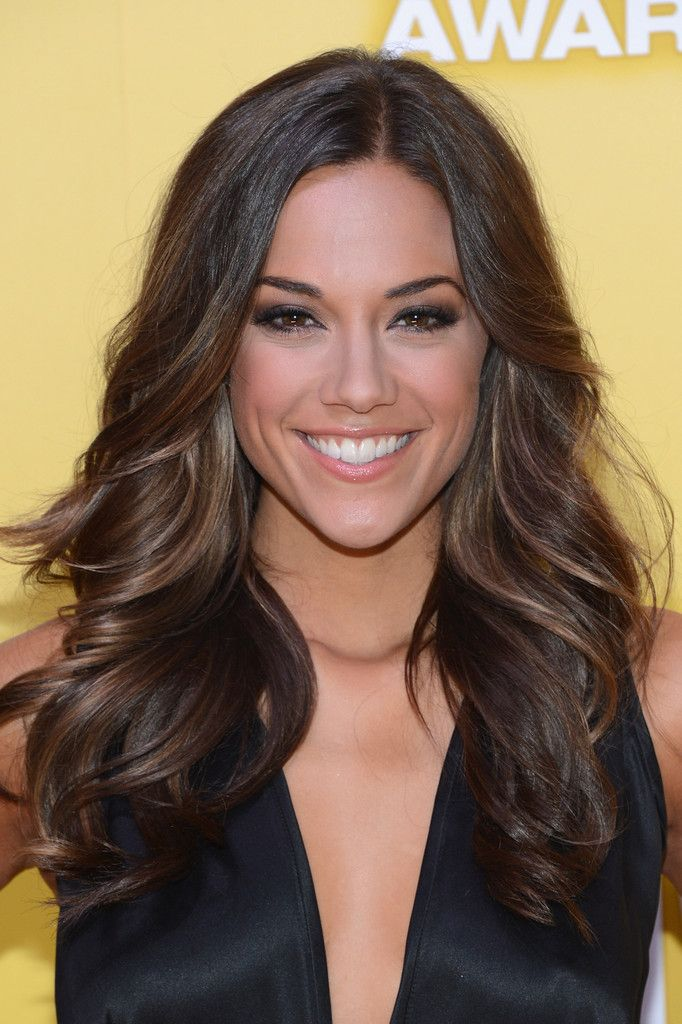 Jana Kramer's soft, long hairstyle with underneath subtle highlights