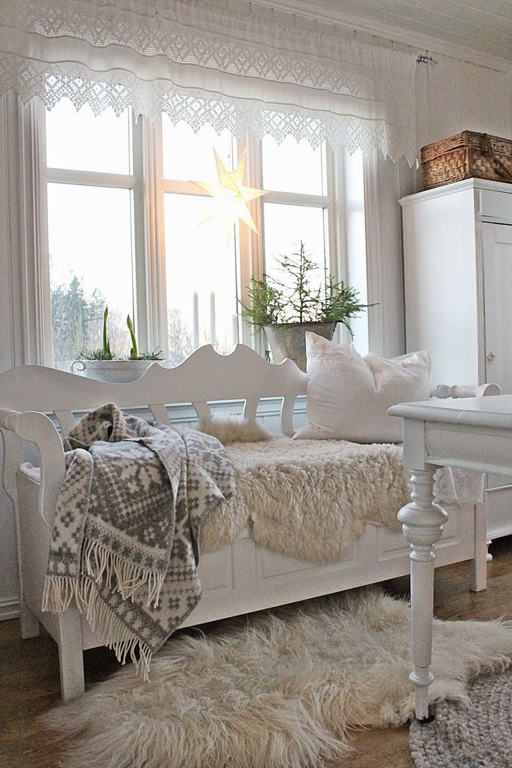 Norwegian country style. Bright fresh white and light. Cosy sheepskins and wool blankets.