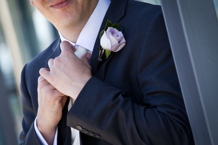 Mens buttonhole featuring a lilac rose