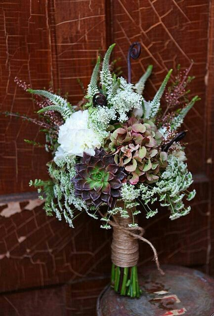 another example of a bouquet with some touches of succulents that i like. i like the jute twine.