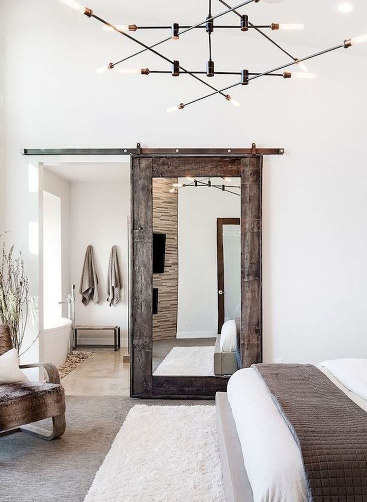 Diy barn door being opened #boho #whitehouse #farmhouse #modern #farmhouse