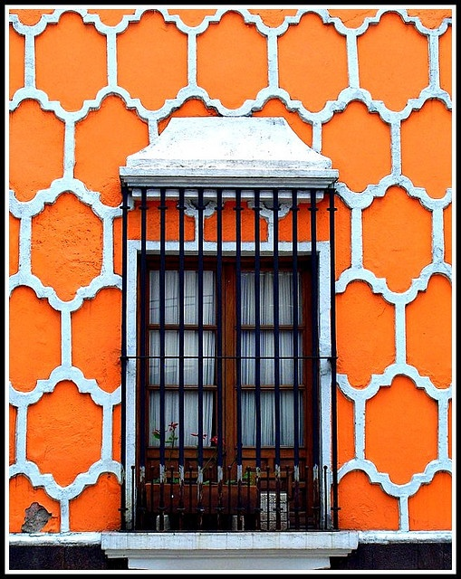 Another fabulous door in Mexico; the bright orange really pops with white.