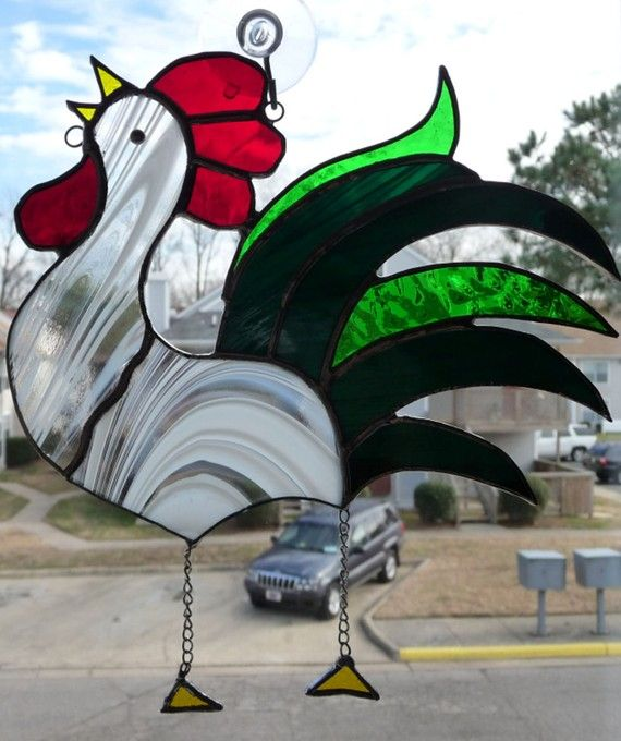 This elegant rooster is a great addition to any window. Custom designed and put together using tiffany method.  Suncatcher measures 7.5 wide by 8 tall.
