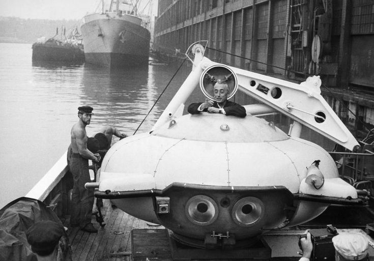 historicaltimes:  Jacques Cousteau climbing into his Diving Saucer on board the 'Calypso' docked in New York Harbor in August 1959.