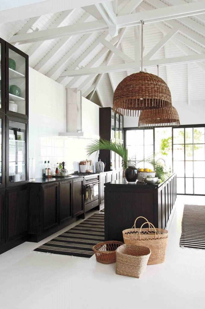 breezy black and white kitchen with exposed white rafters, woven pendant lights