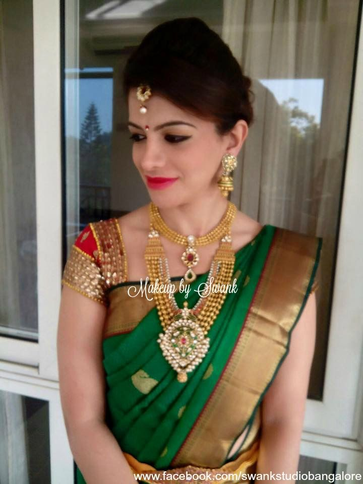 Our client is all dolled up for her special occasion. Makeup and hairstyle by Swank Studio. Perfect example of what to wear to an Indian wedding. Silk Saree. Gold jewellery. Maang tikka. Statement saree blouse design. Hairstyle. Jhumkis. Red lips. Find us https://www.facebook.com/SwankStudioBangalore