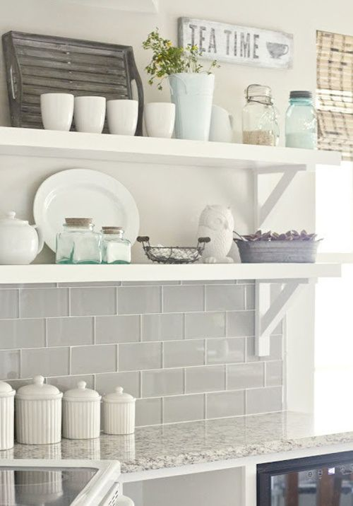 open shelving in the kitchen. Gray glass tile. lovely! I have open shelving... unfortunately all apartments are sorta already made. So I brought my shelving outside the kitchen :)