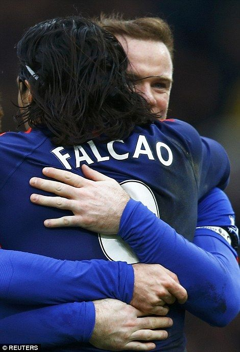 Rooney and Falcao hug after making it 1-1