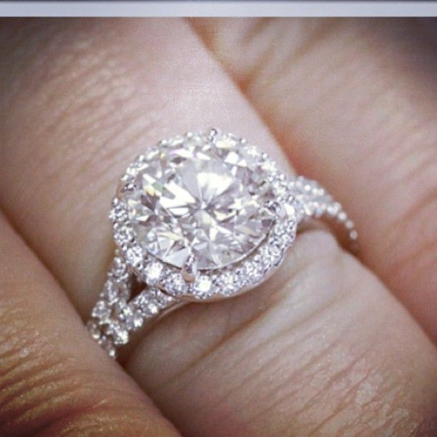 Halo Engagement Ring With Round Cut Center Stone And Split Shank Pave Band