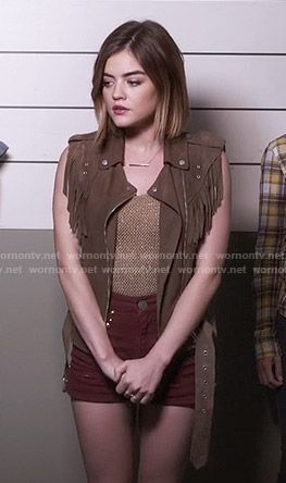 Aria's fringed vest and red studded shorts on Pretty Little Liars.  Outfit Details: https://wornontv.net/56276/ #PLL