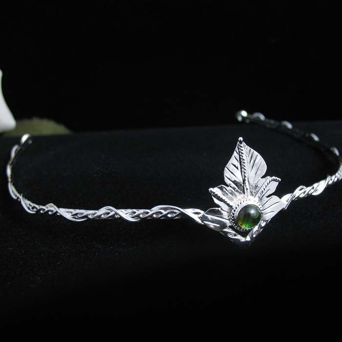 Elvish Woodland Leaf Circlet Wedding Headpiece with Natural Green Tourmaline Cabochon. camias, via Etsy.