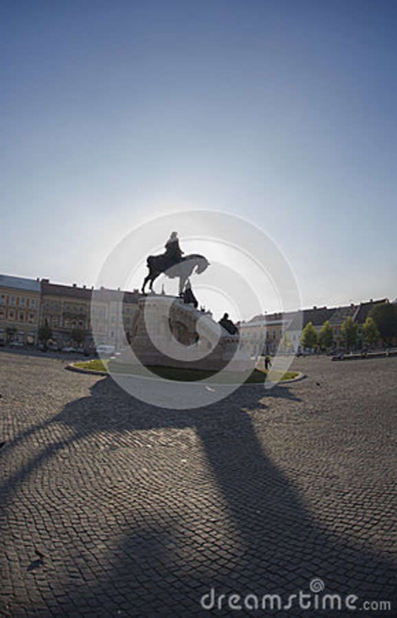 "The famous King Matthias Equestrian Statue memorial in sunrise (made by Fadrusz János in 1902 on the ""Unification Square"" (Piata Unirii) in the center of Cluj Napoca (Kolozsvár, Klausenburg), Transylvania, Romania."