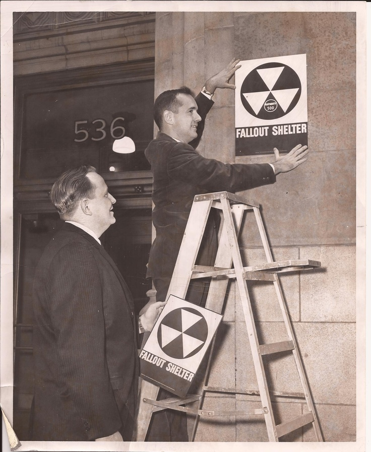 installing fallout shelter signs in 1960s chicago