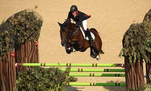 Nick Skelton on his horse Big Star on their way to winning the individual…
