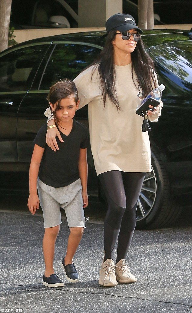 Mummy's boy: Kourtney Kardashian's eldest child Mason looked to be growing up fast as he helped his mother run errands in Thousand Oaks, Los Angeles, on Tuesday