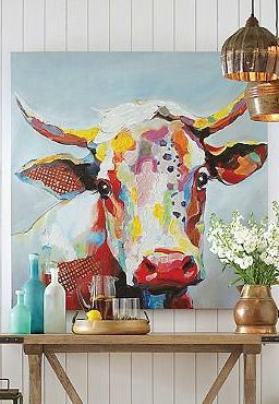 Sure to charm your guests, the Bessie Wall Art features a darling portrait of a colorful cow, perfect for any room.