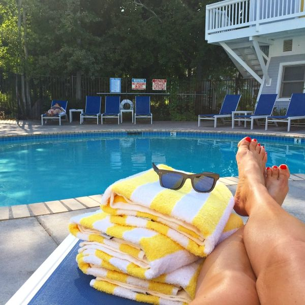 """""""There's also an outdoor saltwater pool with a hot tub. Obviously, my heart did a happy dance again when I saw these yellow and white striped pool towels and the gorgeous blue lounge chairs. :)"""" A Sister """"Staycation"""" at Lithia Springs Resort, Ashland, Oregon 