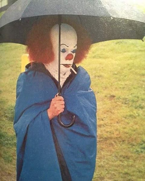 Tim Curry taking a cigarette break on the set of IT.  #itthemovie #stephenking…