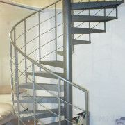 Powder Coated Steel Treads spiral stair in a shop in Manchester
