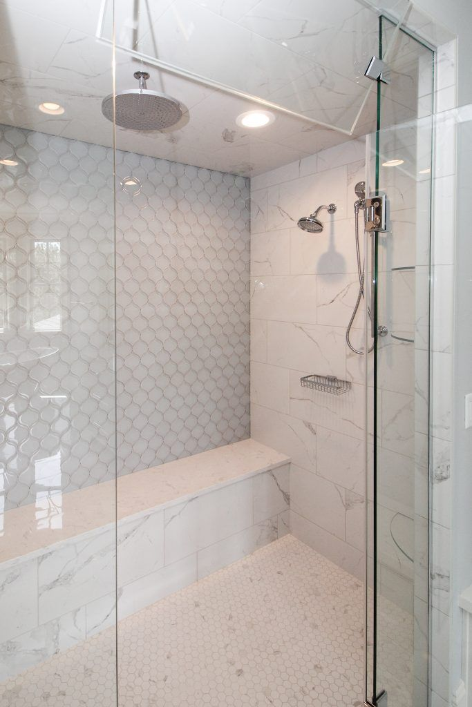 white tiled shower with blue glass