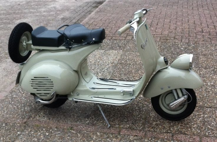 Piaggio Vespa Model VN2T from 1956 in MISA specification with some period correct accessories such as the suspensioncover, odometer, pillion seat and a spare tire. This scooter was once assembled in Jette near Brussels (Belgium) at the Motor Industry SA (MISA) factory that build 1000 scooters each day during 1955 up until 1962 under Piaggio's license.