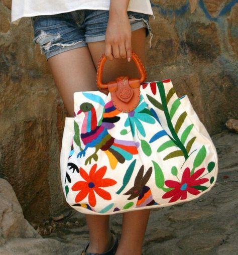 Creo que es una bolsa de estilo étnico mexicano! Leather Otomi Handbag Available again by CasaOtomi on Etsy